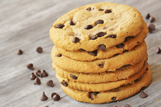 Chocolate chip cookies on a weathered wood background
