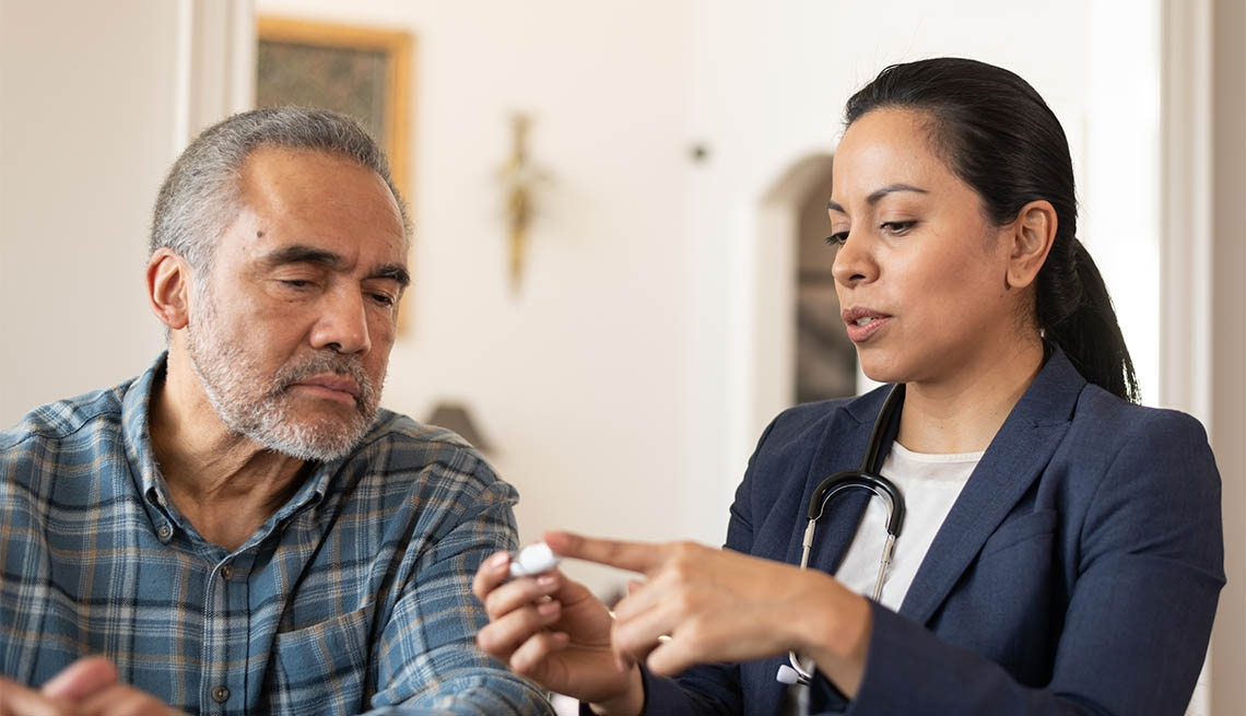 Latin Female Doctor Helping Patient at Home With Diabetes
