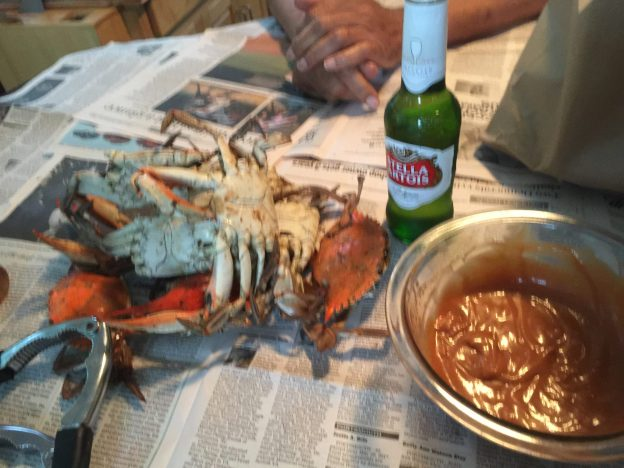 Crabs over newspaper